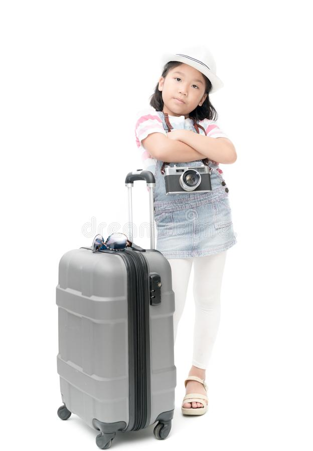 Happy traveler girl in hat and camera traveling with suitcase. stock photo