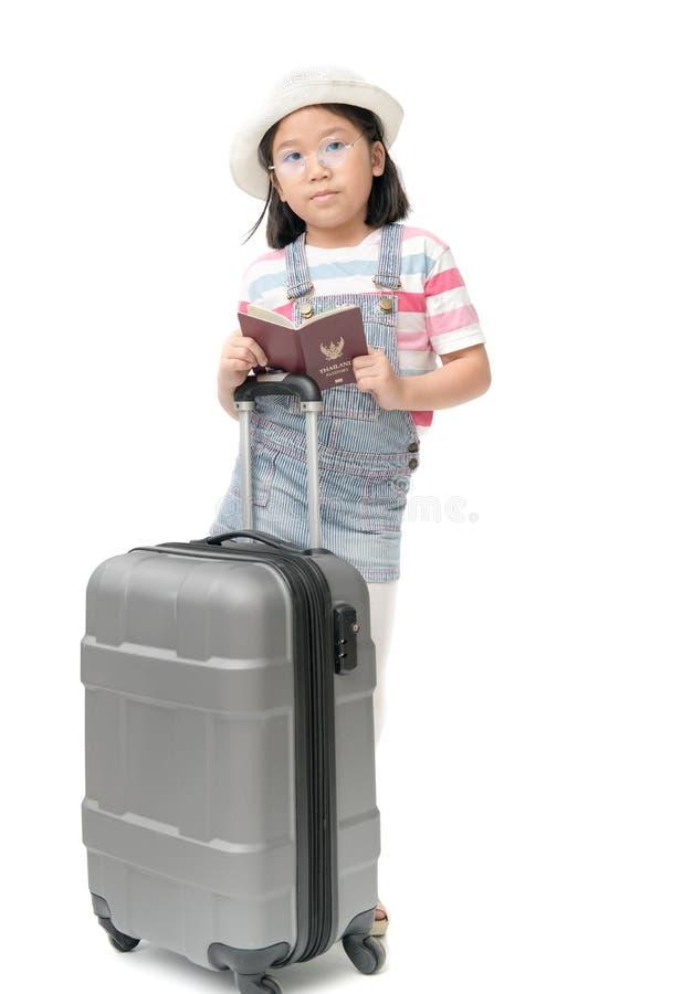 Happy traveler girl in hat holding passport stock photography