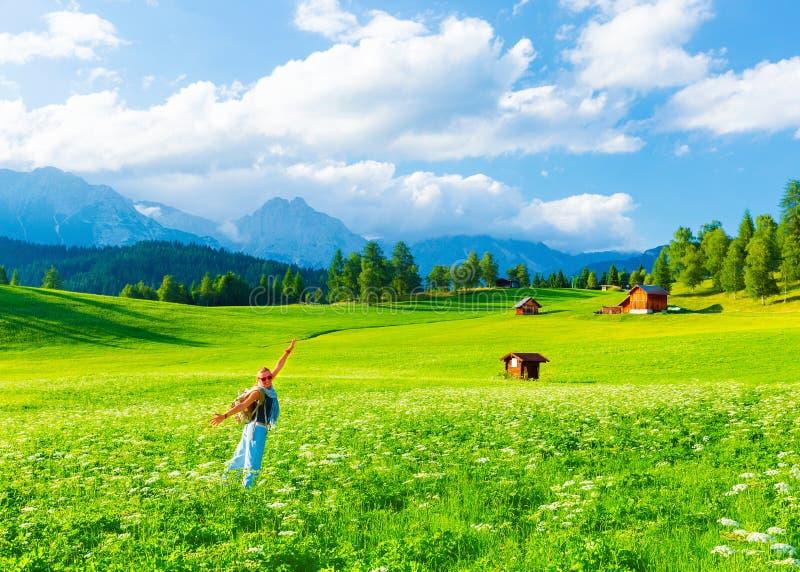 Happy traveler girl in mountainous valley stock photo