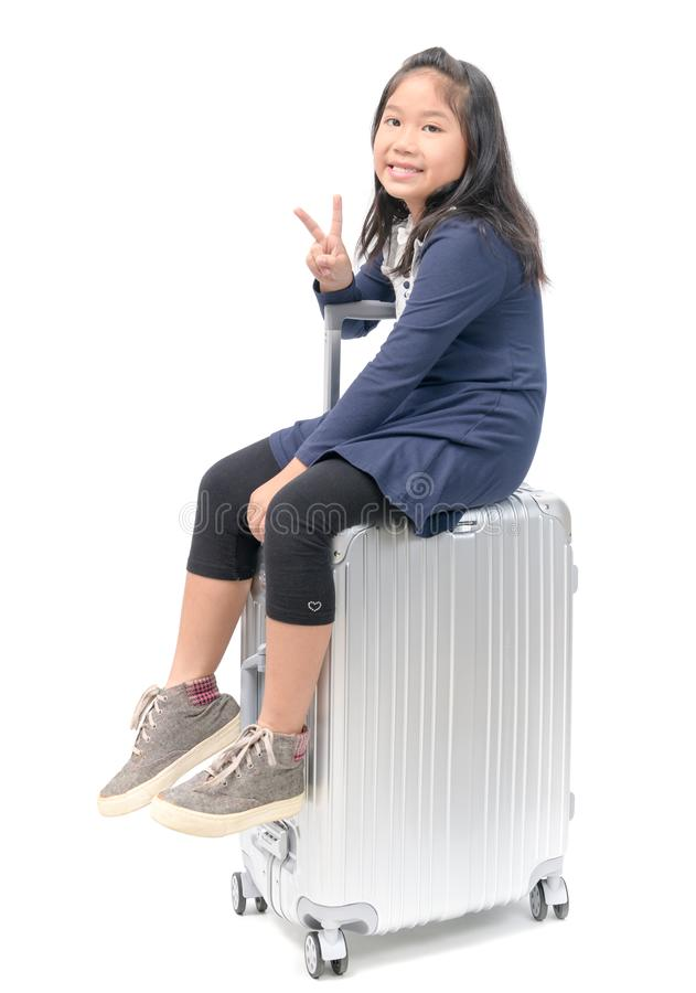 Happy traveler kid sit on baggage isolated royalty free stock photography