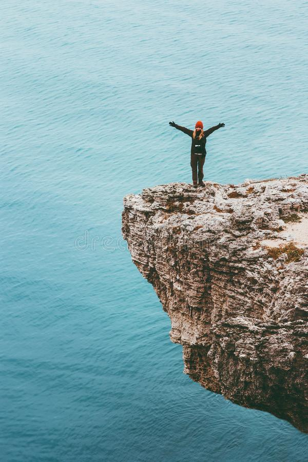 Free Happy Traveler On Cliff Above Sea Hands Raised Travel Lifestyle Success Motivation Concept Adventure Active Stock Photos - 102204043