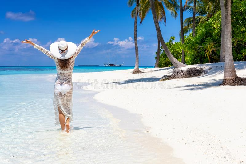 Traveler woman enjoys her tropical beach vacation royalty free stock photography