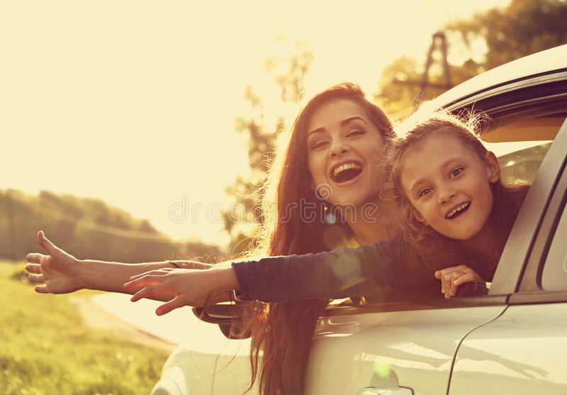 Happy traveling laughing mother and kid girl looking from the ne royalty free stock images
