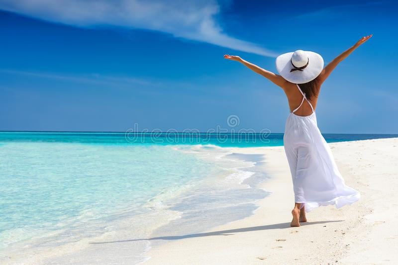 Happy traveller woman enjoys her tropical beach vacation stock photography