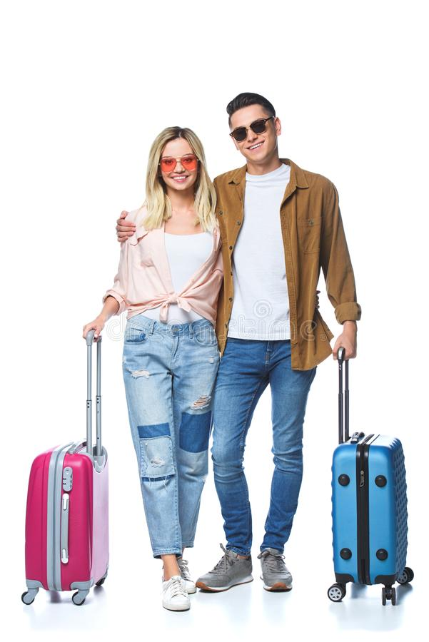 Free Happy Travelling Couple With Suitcases Looking At Camera Stock Image - 129085671