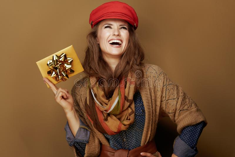 Happy trendy 40 year old woman looking up at copy space stock photos