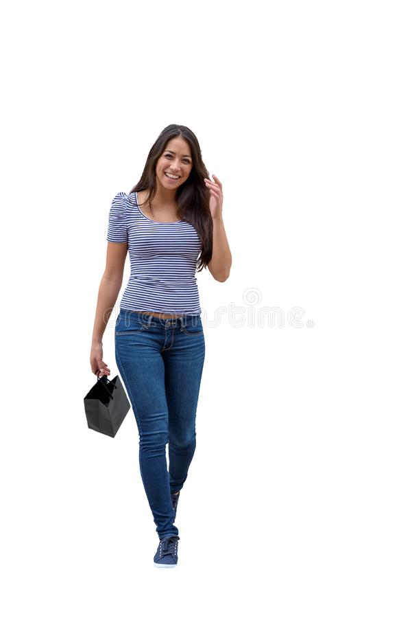 Happy trendy young woman out shopping royalty free stock images