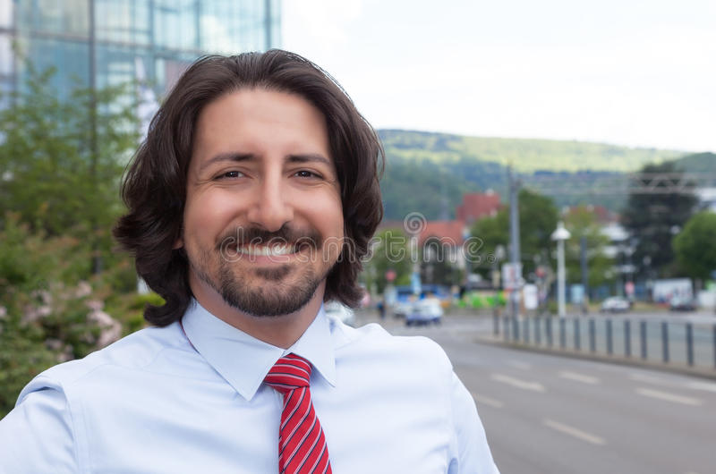 Happy turkish businessman outside in front of his office stock photo