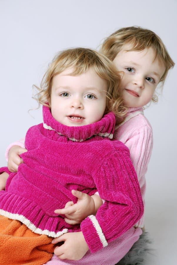 Happy twin girls royalty free stock photo