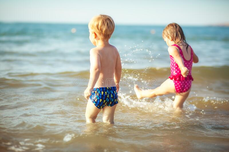 Funny twins at the sea royalty free stock photography