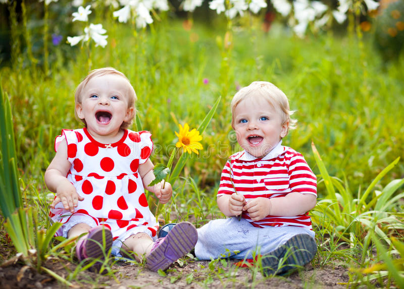 Happy twins outdoor stock image