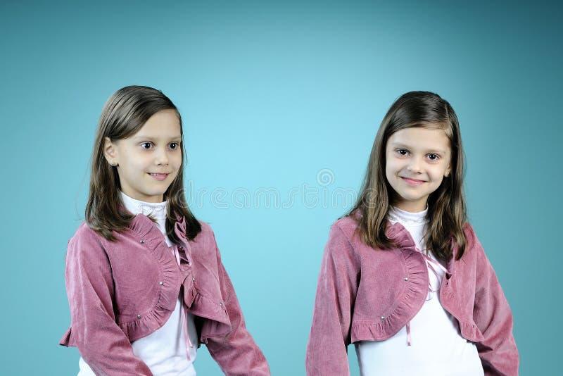 Download Happy Twins Posing In Studio Stock Photo - Image: 13447916