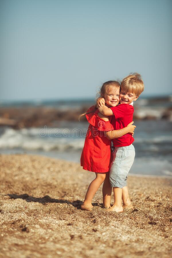 Happy twins at the sea royalty free stock image