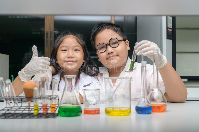Happy two children making science experiments stock photography