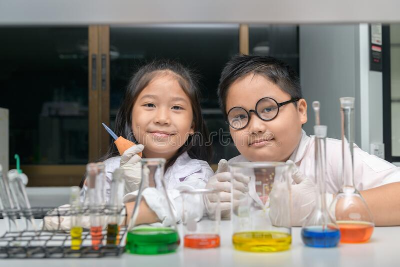 Happy two children making science experiments royalty free stock photos