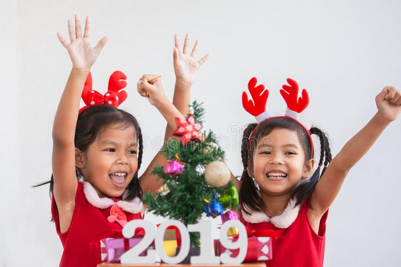 Happy two cute asian child girls with numbers 2019 stock images