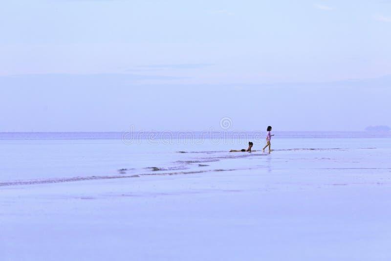 Happy two girls enjoying on the beach royalty free stock photos