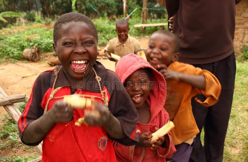 Happy Ugandan Children Eating Sugarcane royalty free stock photos