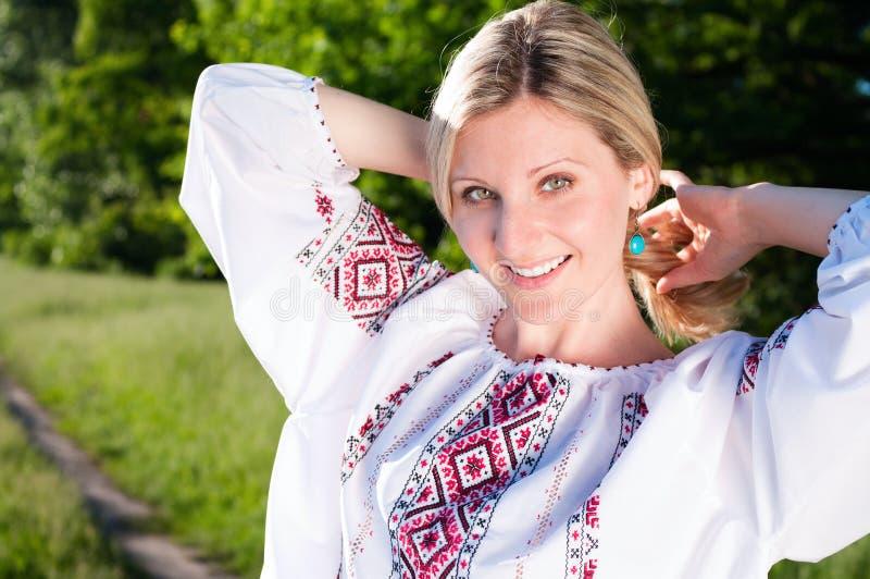 Happy ukrainian woman outdoors on stock photo
