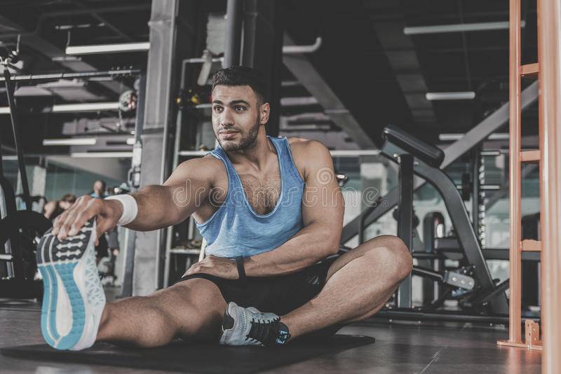 Happy unshaven male practicing in health club royalty free stock image