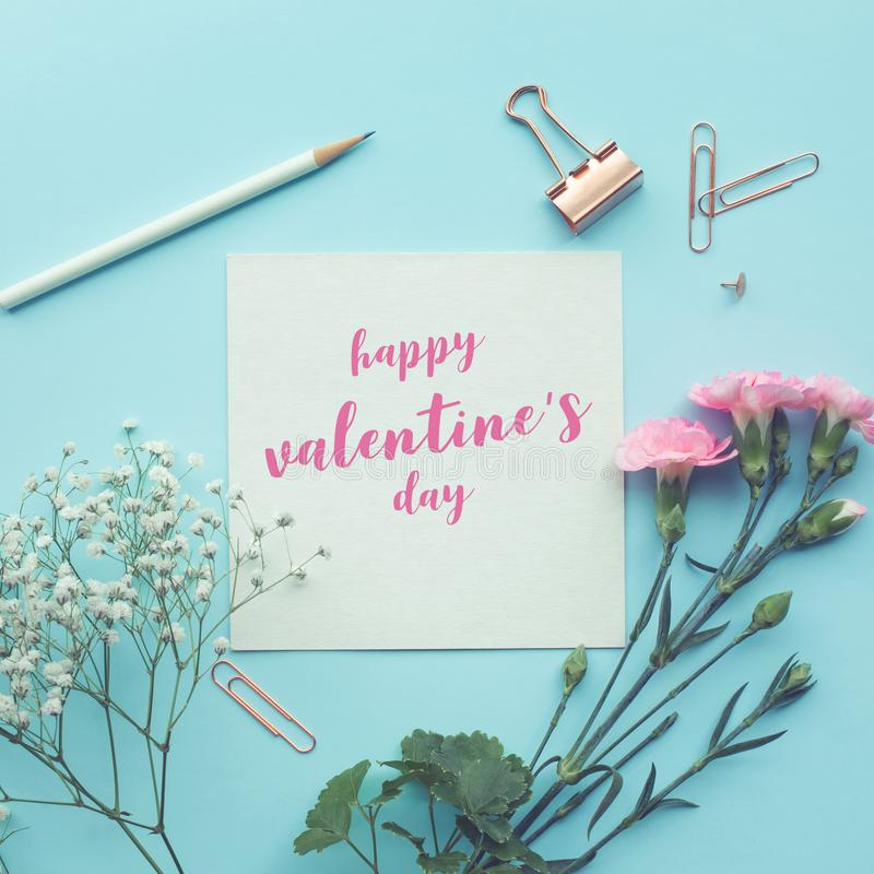 Happy valentine's day white paper space with flower on pastel royalty free stock photo