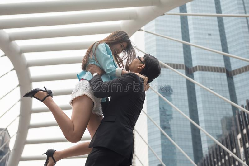 Happy valentine day for couple in town. Happy Asian couple enjoy Valentine day and love anniversary in urban city with building architecture background and copy stock images