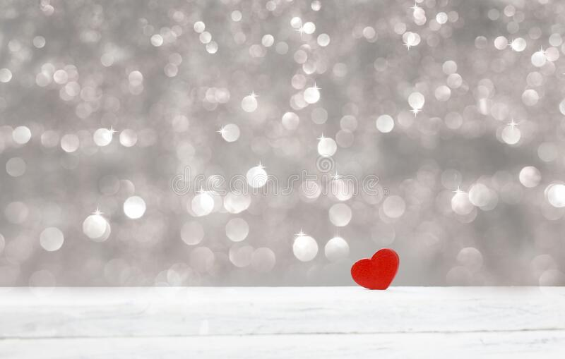 Happy Valentine love day background with red hearts. Happy Valentine day background with  red hearts on white wood and silver bokeh glister with copy space royalty free stock photos