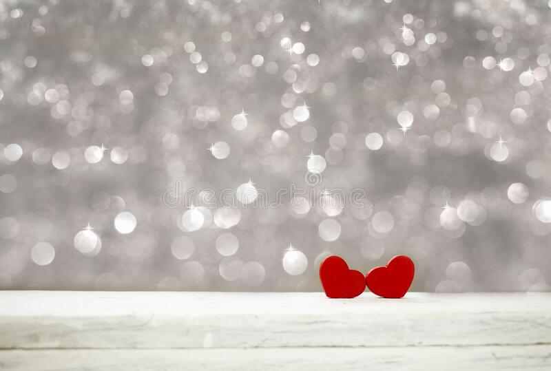 Happy Valentine love day background with two red hearts. Happy Valentine day background with two red hearts on white wood and silver bokeh glister with copy stock photo
