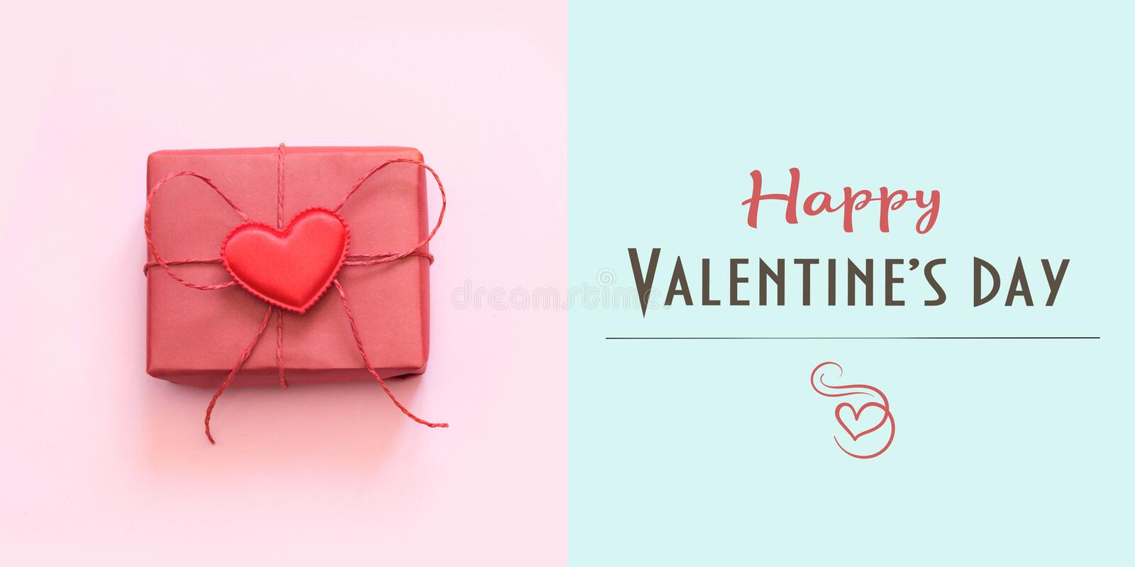 Happy Valentine`s day card with red gift on blue. Minimal concept royalty free stock photo