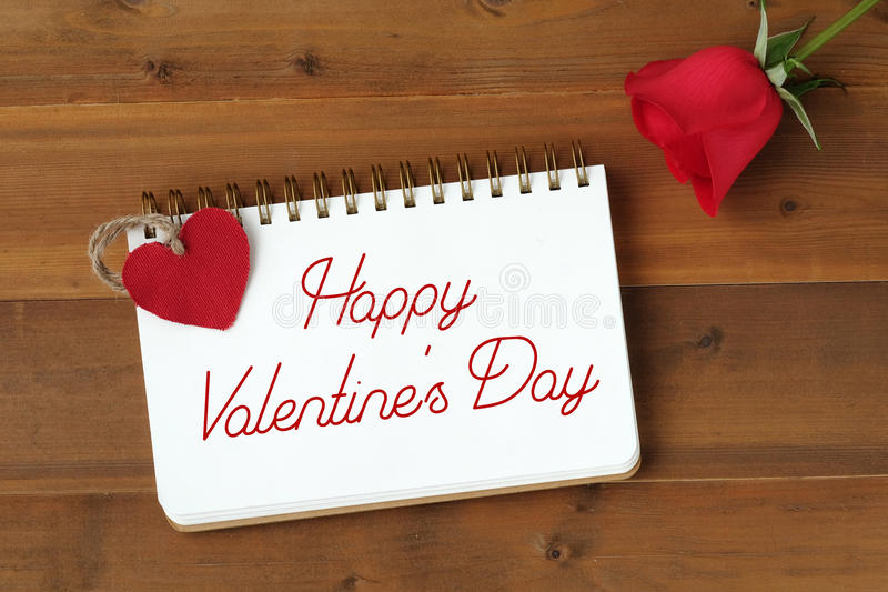 Happy valentine`s day card with red rose and fabric heart shape royalty free stock photography