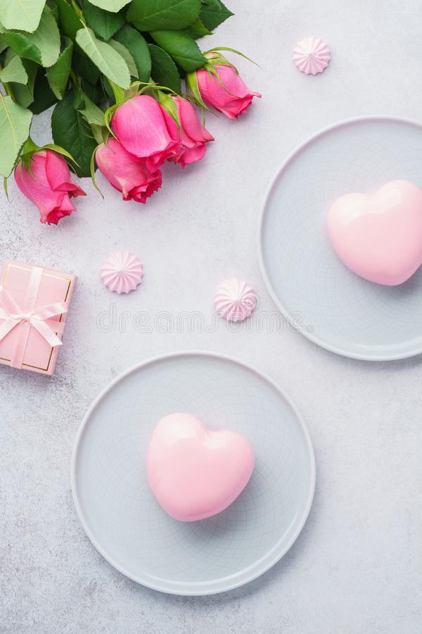 Happy Valentines day morning with heart shaped mousse cakes. Happy Valentines day morning with heart shaped mousse cakes, gift box and flowers. Romantic dessert stock images