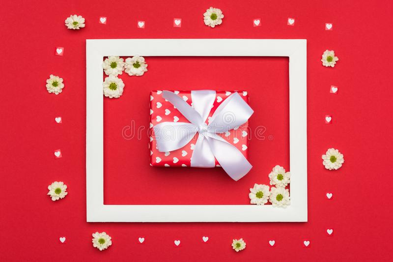 Happy Valentine`s Day, Mother`s Day, Women`s Day or Birthday Background. Flat lay with beautifully wrapped present. Happy Valentine`s Day, Mother`s Day, Women`s royalty free stock photos