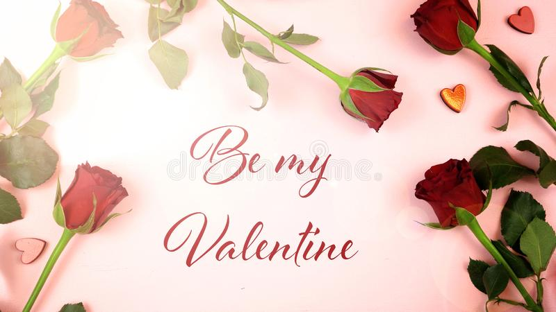 Happy Valentine`s Day overhead background with greeting text and lens flare. stock images