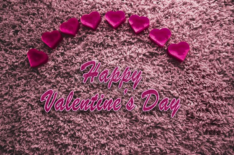 Happy Valentines day with pink hearts background above stock photo