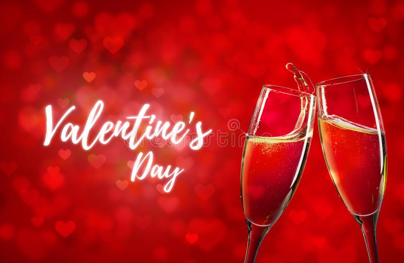 Happy Valentine`s Day. Red hearts background and two champagne glasses royalty free stock photos