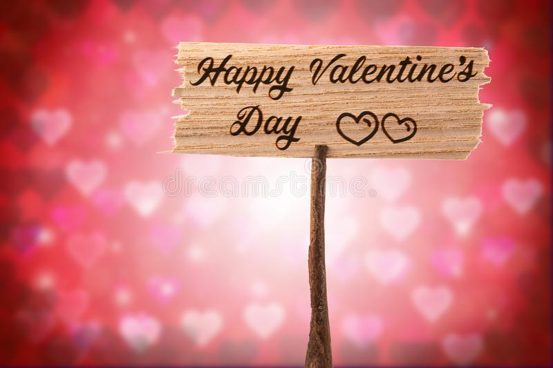 Happy valentine`s day. On wood sign , heart shape background stock image