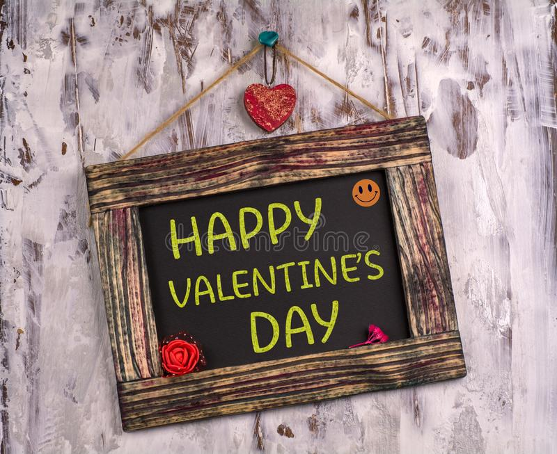 Happy valentine`s day written on Vintage sign board. Happy valentine`s day written on Vintage wooden sign board hanging on color white wood with heart and flower royalty free stock photos