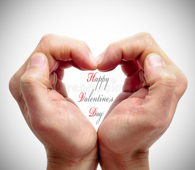 Happy valentines day. Man hands forming a heart and the sentence happy valentines day royalty free stock photos