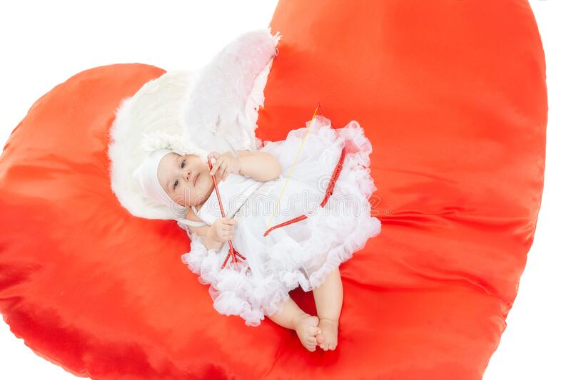 Cupid in white wings with bow and arrows in studio at white background, isolated royalty free stock photography