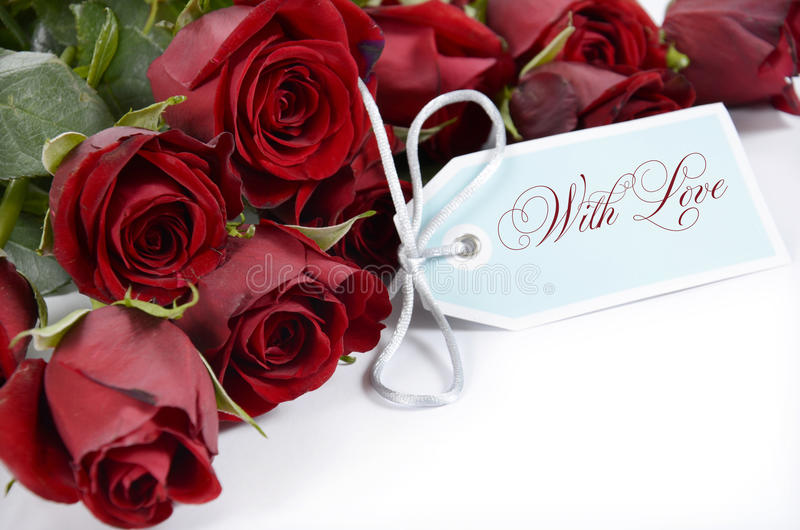 Happy Valentines Day bouquet of red roses. On white background and With Love greeting tag card stock image
