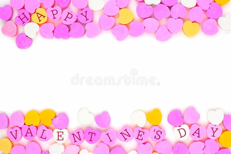 Happy Valentines Day candy hearts double border over white. Pastel colored candy hearts with Happy Valentines Day text forming a double border over white royalty free stock photos
