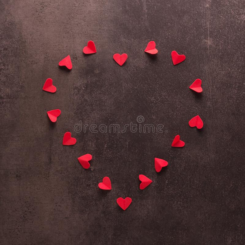 Happy valentines day concept. Bright beautiful heart of small red hearts on dark background royalty free stock images