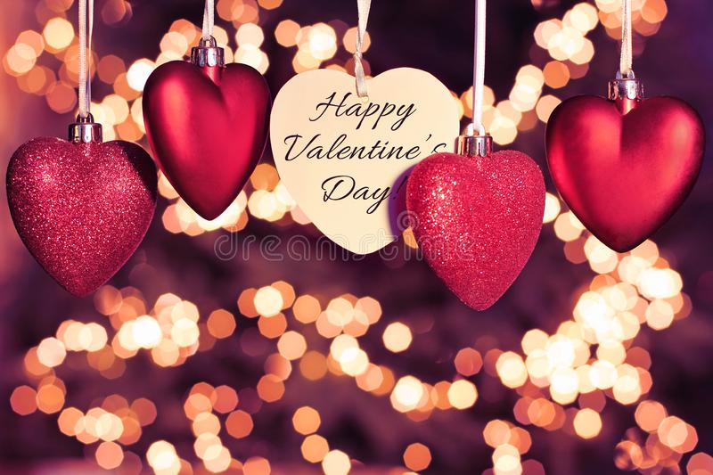 Happy Valentines Day greeting card. Beautiful red hearts stock image