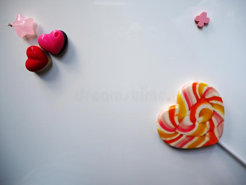 Heart shape candy colorful and heart chocolate pink and red on white background. stock photos