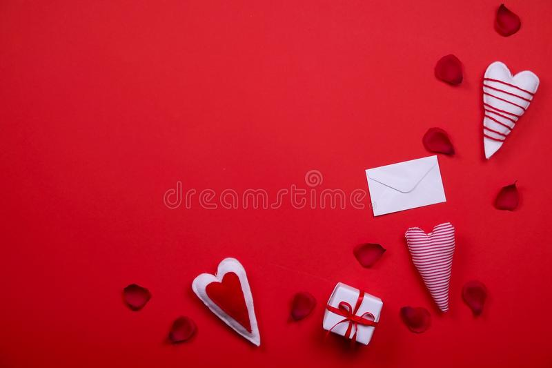 Happy valentines day / love symbols concept on bright red background. Romantic happy valentines day concept, love symbols, heart shapes on solid red paper royalty free stock photography