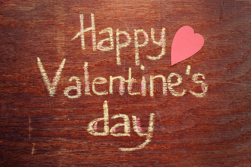 Happy Valentines day note on wood background. Happy Valentines day chalk note on wood background royalty free stock photos