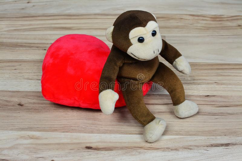Happy Valentines Day, the plush monkey and the red heart. royalty free stock images