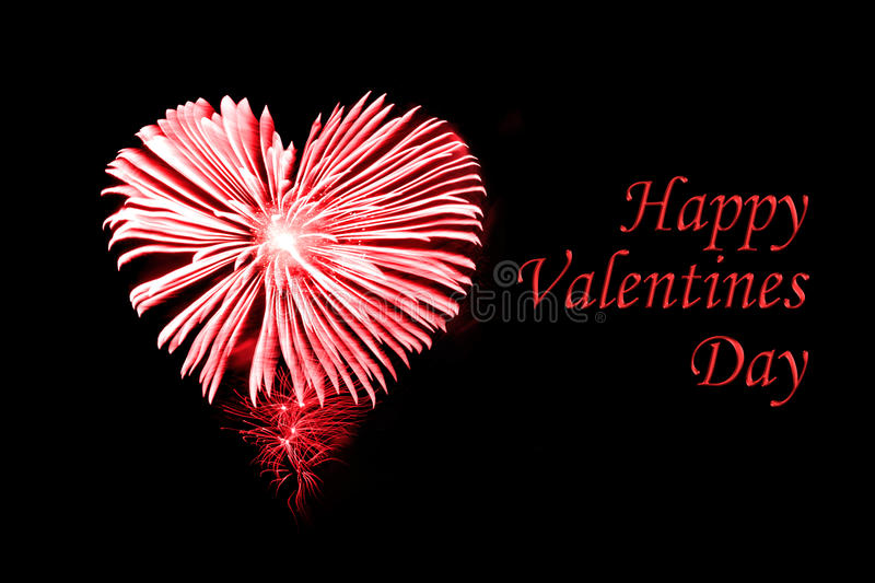 Happy valentines day, red fireworks in shape of a heart stock images