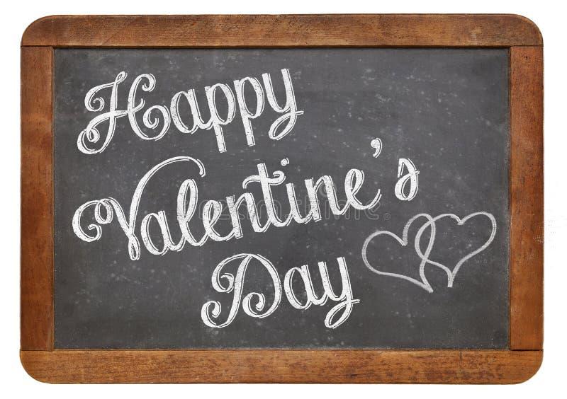Happy Valentines Day. Happy Valentine's Day - whtie chalk text on a vintage slate blackboard royalty free stock photo