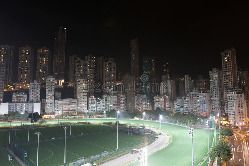 Happy Valley Racecourse, Hong Kong. Happy Valley Racecourse at night, many buildings around the racecourse. Surrounded by skyscrapers and looped by Hong Kong royalty free stock images